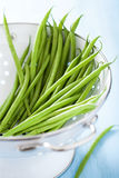 Fresh green beans in colander Royalty Free Stock Photography