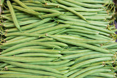 Fresh green beans at the farmers market. The texture may be used for printing on fabric or paper, as background and in web design stock photo