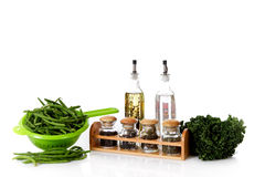 Fresh green beans and herbs, vinegar and oil Royalty Free Stock Photo