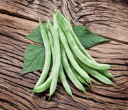 Fresh green beans on the old wood. Royalty Free Stock Image