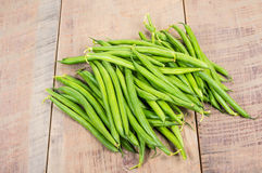 Fresh green beans on table. Freshly picked green or snap beans on a wooden table stock images