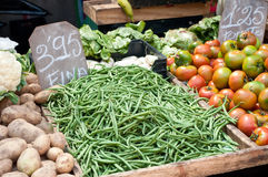 Fresh green beans and various vegetables at the marke Royalty Free Stock Images