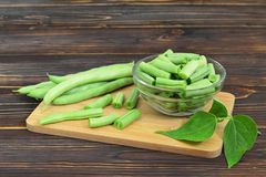Fresh green beans. On wooden background royalty free stock photography