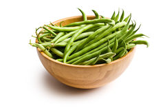 Fresh green beans in wooden bowl. The fresh green beans in wooden bowl Royalty Free Stock Photos