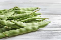 Fresh green beans on table. Fresh green beans on wooden table royalty free stock images