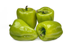 Fresh green bell pepper (capsicum) on a white background. Stock Images