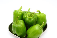 Fresh green bell peppers (capsicum) on a white background Royalty Free Stock Photography