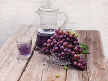 Fresh green and blue grapes.A carafe of grape juice Stock Photos