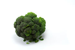 Fresh green broccoli. Clump of fresh green broccoli isolated on white background Stock Photo
