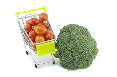 Fresh Green broccoli, cherry tomatoes on trolley. Isolated on white background Royalty Free Stock Image