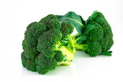 Fresh green broccoli isolated on white background.  Royalty Free Stock Images
