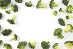 Broccoli on white background with copy space. Fresh green broccoli isolated on white background. Top view. Copy space in the center stock photos
