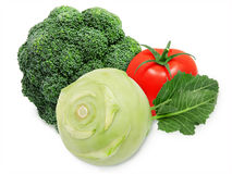 Fresh green broccoli, kohlrabi and red tomatoes Royalty Free Stock Image