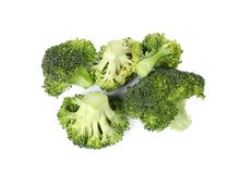 Fresh green broccoli on white background. Organic food. Fresh green broccoli on white background, top view. Organic food stock photography
