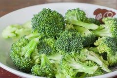 Fresh green broccoli on white dish. Fresh green broccoli cut on white dish Royalty Free Stock Image