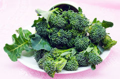 Fresh green broccoli on white dish Royalty Free Stock Photos