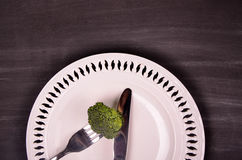 Fresh green broccoli on white plate over wooden background Stock Photo