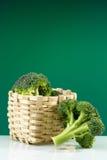 Broccoli. Fresh green broccoli with wicker basket Royalty Free Stock Photos