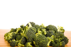 Fresh Green Broccoli on Wood Table Stock Images