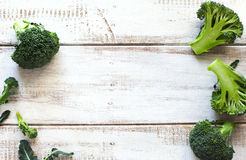 Fresh green broccoli on wooden background Stock Photography