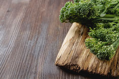 Fresh green broccoli on a wooden board. Royalty Free Stock Image