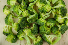 Fresh green broccoli on wooden cutting board close up. Stock Photography
