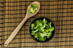 Fresh green broccoli on wooden cutting board close up. Stock Photos