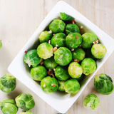 Fresh Green Brussels Sprouts on White Bowl Royalty Free Stock Photos