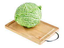 Fresh green cabbage head on wooden chopping board Royalty Free Stock Photo