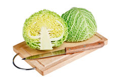 Fresh green cabbage with knife on wooden board Stock Photography