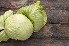 Fresh green cabbage on a wooden table Stock Images