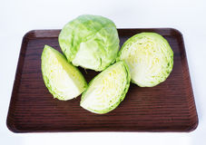Fresh green cabbages and slice cabbages Stock Photo