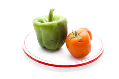 Fresh Green Capsicum with Red Tomatoes Stock Photos