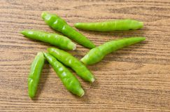 Fresh Green Chili Pepper on A Wooden Table Stock Photos