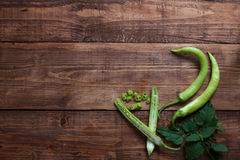Fresh green chillies on wooden chopping board. Royalty Free Stock Image