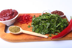 Fresh green cilantro, coriander leaves, tomato paste, chili pepper and spices on a wooden board. Ingredients for meat Stock Photos