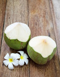Fresh green coconut with plumeria Royalty Free Stock Photo