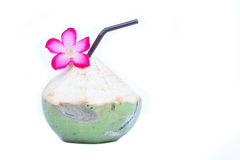 Fresh Green coconuts with drinking straw and flower isolated on Stock Photo