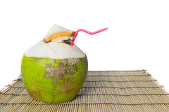 Fresh Green coconuts with drinking straw isolated on white backg Royalty Free Stock Photos