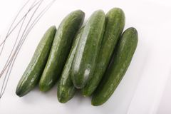 Fresh green cucumber on white. Fresh some green cucumber on white background royalty free stock image
