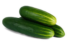 Fresh Green Cucumbers. Stack of three fresh green cucumbers on a white background with shadow show a healthy vegetarian food Royalty Free Stock Image
