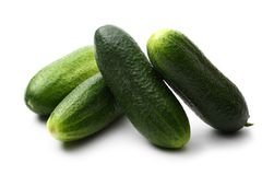 Fresh green cucumbers. On white Stock Photos
