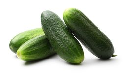 Fresh green cucumbers. On white Stock Image
