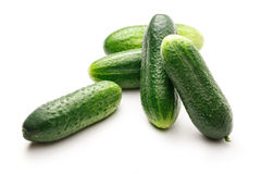 Fresh green cucumbers on white. Fresh green cucumbers on the white background Stock Photography