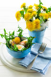 Fresh green dandelion salad on blue bowl Royalty Free Stock Image