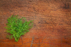 Fresh green dill herb on rustic wood Stock Photos