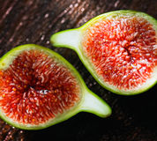 Fresh Green Figs. Delicious vibrant honey sweet green fig. Figs halved Royalty Free Stock Photos