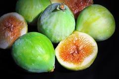 Fresh green figs on black background Stock Photo