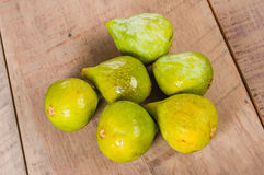 Fresh green figs picked ripe on a table Royalty Free Stock Images