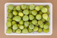 Fresh green figs on a plastic container viewed from above Stock Photography
